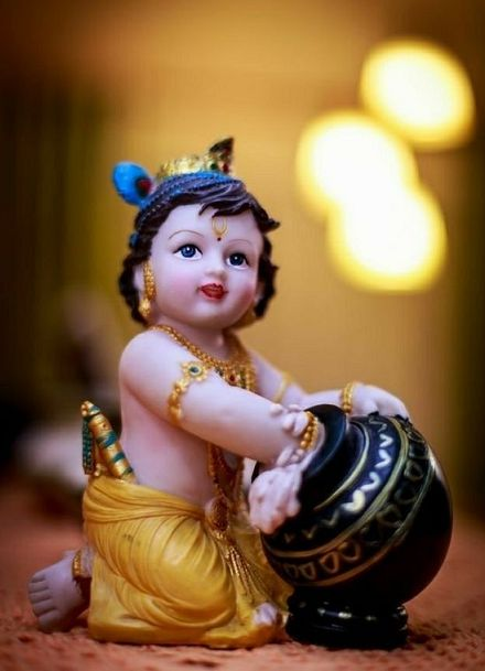 Pictures of Lord Krishna Eating Makhan