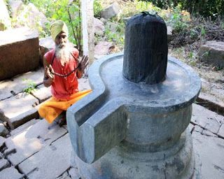 Worshiping Shivling Photo